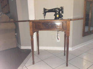 Antique singer sewing machine in table