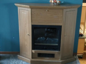 Portable electric fire place in oak cabinet