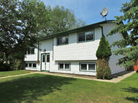 **JUST REDUCED** CONSIDER This Family Home Across from the Park