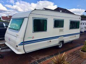 Adria caravan 4 birth fixed bed