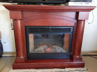 Mahogany electric fireplace. Great condition