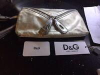 Dolce & Gabbana metallic clutch with £360 receipt