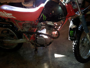 Two honda dirtbikes
