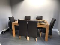 Dining table + 6 leather chairs £500 ono