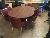 Dark meeting table with leather chairs.
