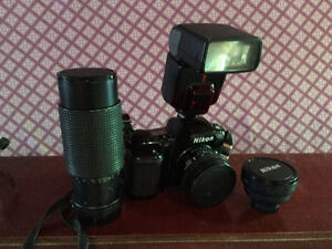 Nikon Camera With Two Lenses and Flash