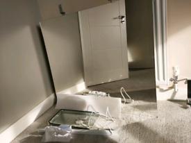 Bathroom mirror with light attachment