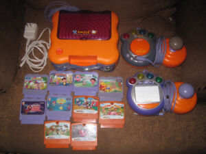 VTECH VSMILE TV LEARNING SYSTEM W 2 CONTROLLERS & 10 GAMES!!