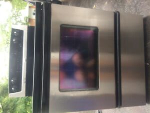 Whirlpool stainless steel stove work condition delivery availabl