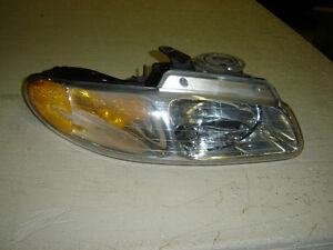 Front passenger head light for 97 voyger caravan Regina Regina Area image 1