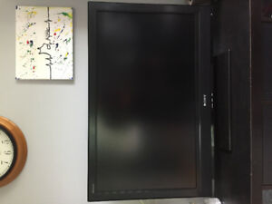 "32"" Sony BRAVIA Flat Screen TV with stand."