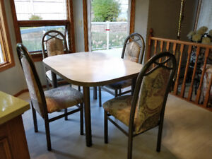 Coffee set with added on piece and 4 chairs