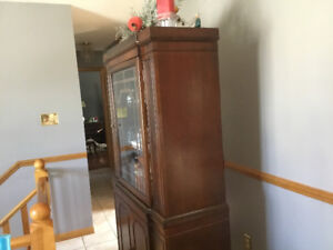 Antique dining suite. Includes table chairs, hutch and buffet