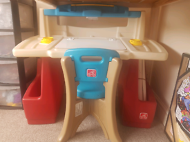 Child's desk and chair with light.