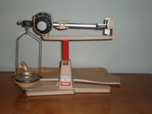 For Sale OHAUS Dial-O-Gram 310g Balance Scale with cloth cover.
