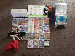 Wii console, games, and many accessories