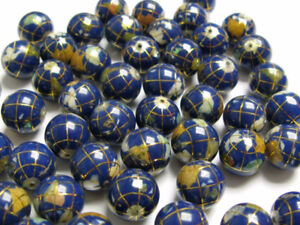 A beautiful 14K inlaid Large Bead Atlas Globe Mother of Pearl