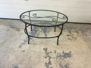 Brown wrought iron oval coffee table
