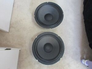A Pair Of Older Celestion G12T-75's