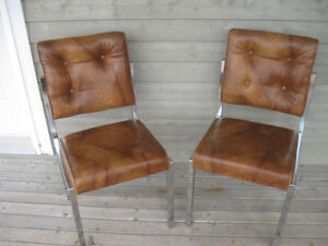 TWO MATCHING CHROMED STACKING CHAIRS...VINYL-COVERED