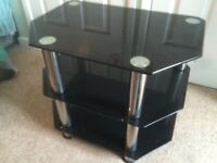 Black glass and chrome steel TV / Audio stand.