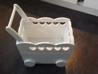 Lovely white wooden toy trolley with handle, wheels. Good condition.