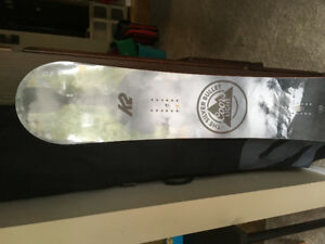 Brand new snowboard with bag.