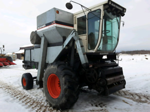 Gleaned L3 combine with 3 heads and header wagon