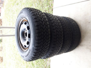 Four snow tires on rims. P 205 /  70 R 15.Fits Pontiac or Toyota