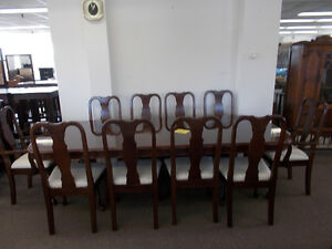 Beautiful dining table and ten matching chairs. $1599.