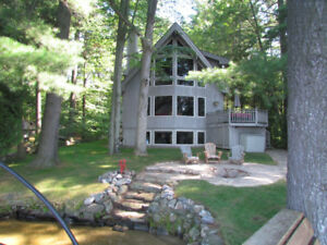Modern 3brm waterfront cottage Lake Muskoka with SW exp