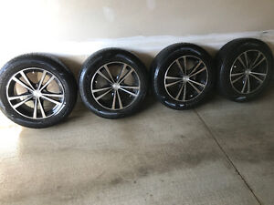 Alloy rims with all weather goodyear tires