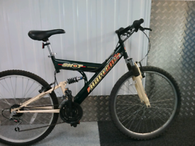 "Used mountain bike,""HARLEM""U.S.A.,full suspension."