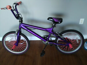 """2 month old PURPLE 20"""" stunt BMX with gyro comes with stunt pegs"""