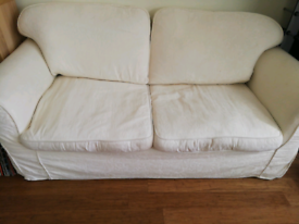 Two seater sofa bed great quality cream free