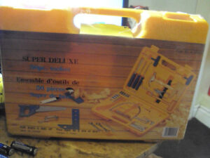A KIDS 56 PC YELLOW BOX REAL TOOL SET WITH PLASTIC STILL ON IT.