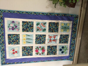 Handmade/hand quilted quilt.
