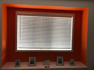 7 gently used white vertical blinds