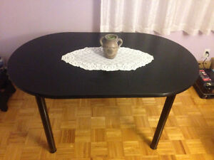 Kitchen table (has middle insert) removable