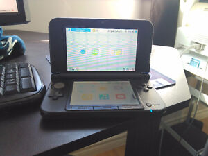 Nintendo 3DS XL  black in good condition comes with charge