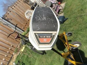 Assortment of 3 outboards and covers