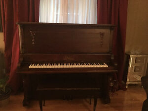 Chopin, Leach Piano with bench seat.