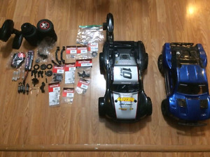 2 traxxas slash 4x4 with extras. make me an ofder