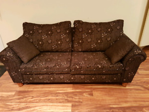 Brown and black floral sofa and cushions