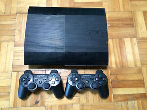 PS3 500go super slim with 2 official controllers + 14 games