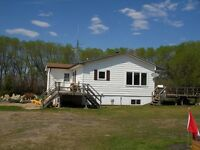 Two homes and 160 acres on this acreage south of Melfort!