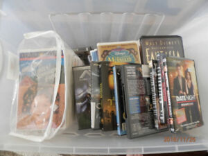 VHS AND DVD MOVIES AND CONTAINER INCLUDED  ALL FOR 25