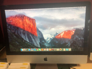 "21.5"" iMac with Windows 7 on half."