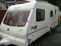 BAILEY PAGEANT LOIRE, 4 BERTH CARAVAN 2002. END WASHROOM. WITH full awning