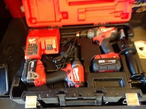 Brand new 18V Milwaukee fuel hammer drill & compact